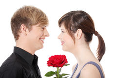 Young couple and rose. Stock Photo