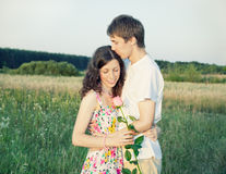 Young couple with rose Stock Image