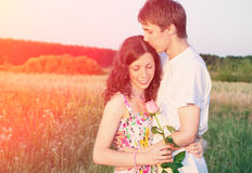 Young couple with rose Royalty Free Stock Image