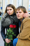 Young couple with roses. Stock Photos
