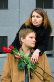 Young couple with roses. Royalty Free Stock Photo