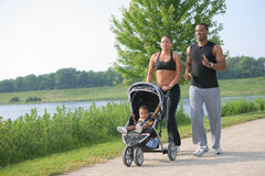 Young Couple Runing Outdoor with Little Boy Royalty Free Stock Image