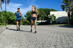 Couple of runners jogging royalty free stock photo
