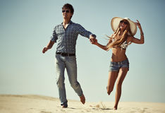Young couple running Royalty Free Stock Photo