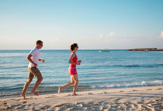 Young couple running Royalty Free Stock Images