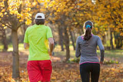 Young couple running in autumn season Stock Images