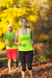 Young couple running in autumn season Stock Image