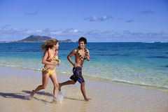 Young couple running on the beach Stock Photography