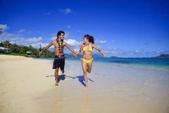 Young couple running on the beach Royalty Free Stock Photography