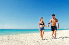 Couple running at the beach. Young couple running at the beach Stock Photos