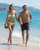 Young couple running at the beach Royalty Free Stock Images