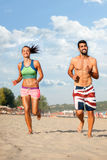 Young couple running on beach Royalty Free Stock Photo