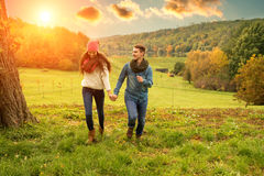 Young couple running on the beautiful scenery royalty free stock photography