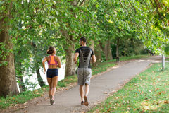 Young couple running in early morning at the park Royalty Free Stock Images