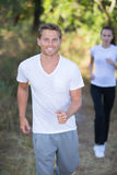 Young couple running in early morning at park Royalty Free Stock Photo