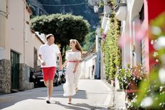 Young couple running and looking each other, Positano, Italy Royalty Free Stock Photo