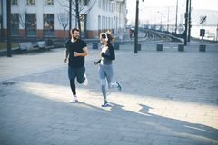 Young couple running in the morning. As a good habit stock photos