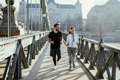 Young couple running in the morning. As a good habit stock images