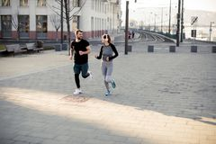 Young couple running in the morning. Young couple running  in the morning as a good habit stock image