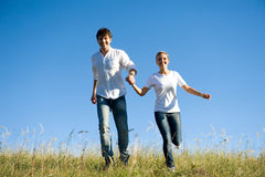Young couple running outdoors Royalty Free Stock Photo