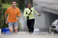 Young couple running outdoors Stock Photography