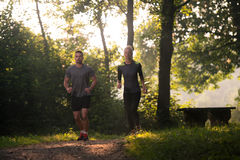 Young Couple Running Outdoors On A Lovely Day Stock Photo