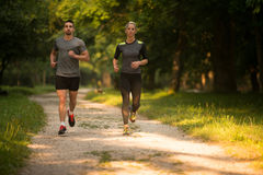 Young Couple Running Outdoors On A Lovely Day Stock Photos
