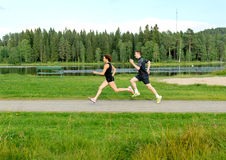 Young couple running outside Stock Image