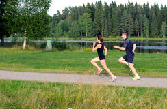 Young couple running outside Stock Photography