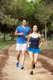 Young couple running in park. And smiling Stock Images