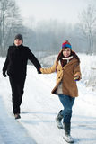 Young couple running through the park. Winter collection: young couple in winter Royalty Free Stock Photos
