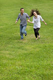 Young couple running in park Royalty Free Stock Photo