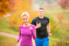 Young couple running in the park Royalty Free Stock Photo