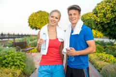 Young couple after running in park Stock Photo