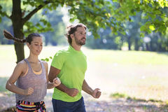 Young couple running in the park. Stock Image