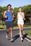 Young Couple Running On Road Stock Image
