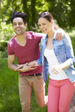 Young Couple Running In Summer Countryside Stock Photo