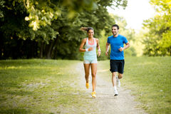 Young couple running Stock Photos