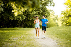 Young couple running Royalty Free Stock Image