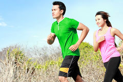 Young couple running together Stock Image