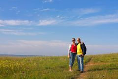 Young couple on rural road Stock Photography