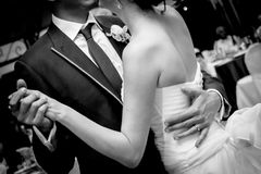 Wedding dance. Young couples dance as husband and wife at wedding reception stock photos