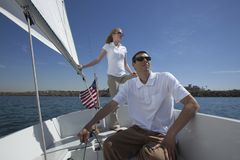 Young couple sailing Stock Image