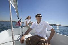 Young Couple Sailing In Boat Royalty Free Stock Photography
