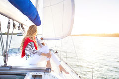 Young couple on a sailing boat at summer Royalty Free Stock Image