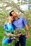 Young couple in the sakura's garden in park Stock Photo