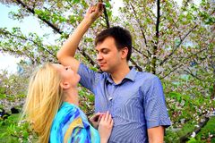 Young couple in the sakuras garden in park. Young couple in the sakuras garden in Vilnius royalty free stock photography