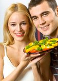 Young couple with salad Stock Photos