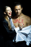 Young couple with sale concept Royalty Free Stock Image