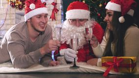 Young couple with Santa celebrating New Year 2017, Christmas stock video footage